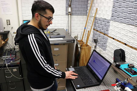 Christian Ybarra '20 works on his thesis at his co-op.