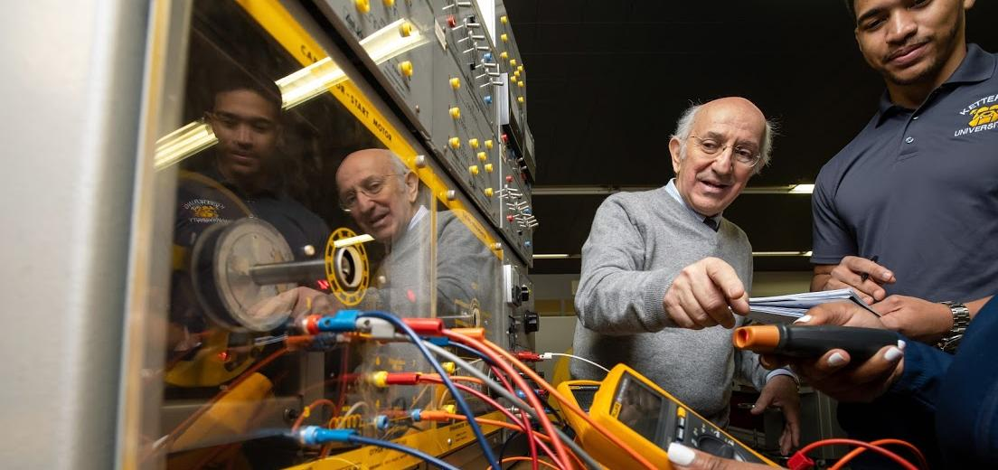 Students work under the guidance of a professor in the Electrical Engineering Machines lab.