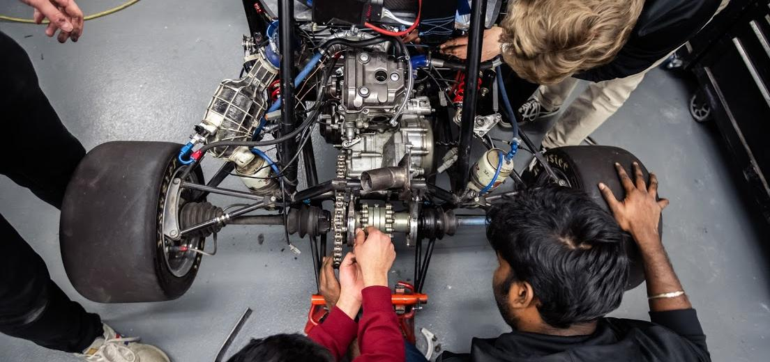 Students work on the SAE Baja vehicle at Kettering University.