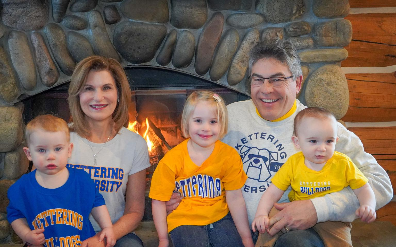 Carla ('83) and Clark ('81) Bailo with their grandkids.