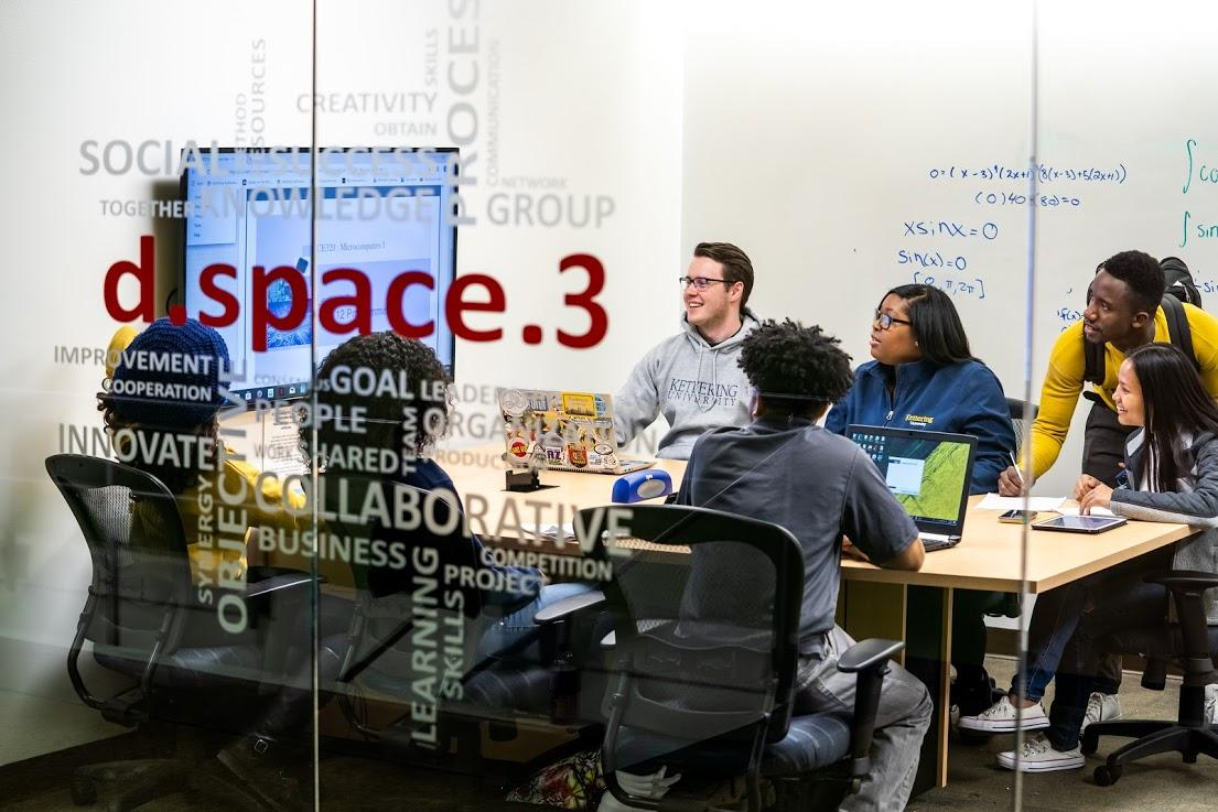 Students working in a group in a campus dspace.