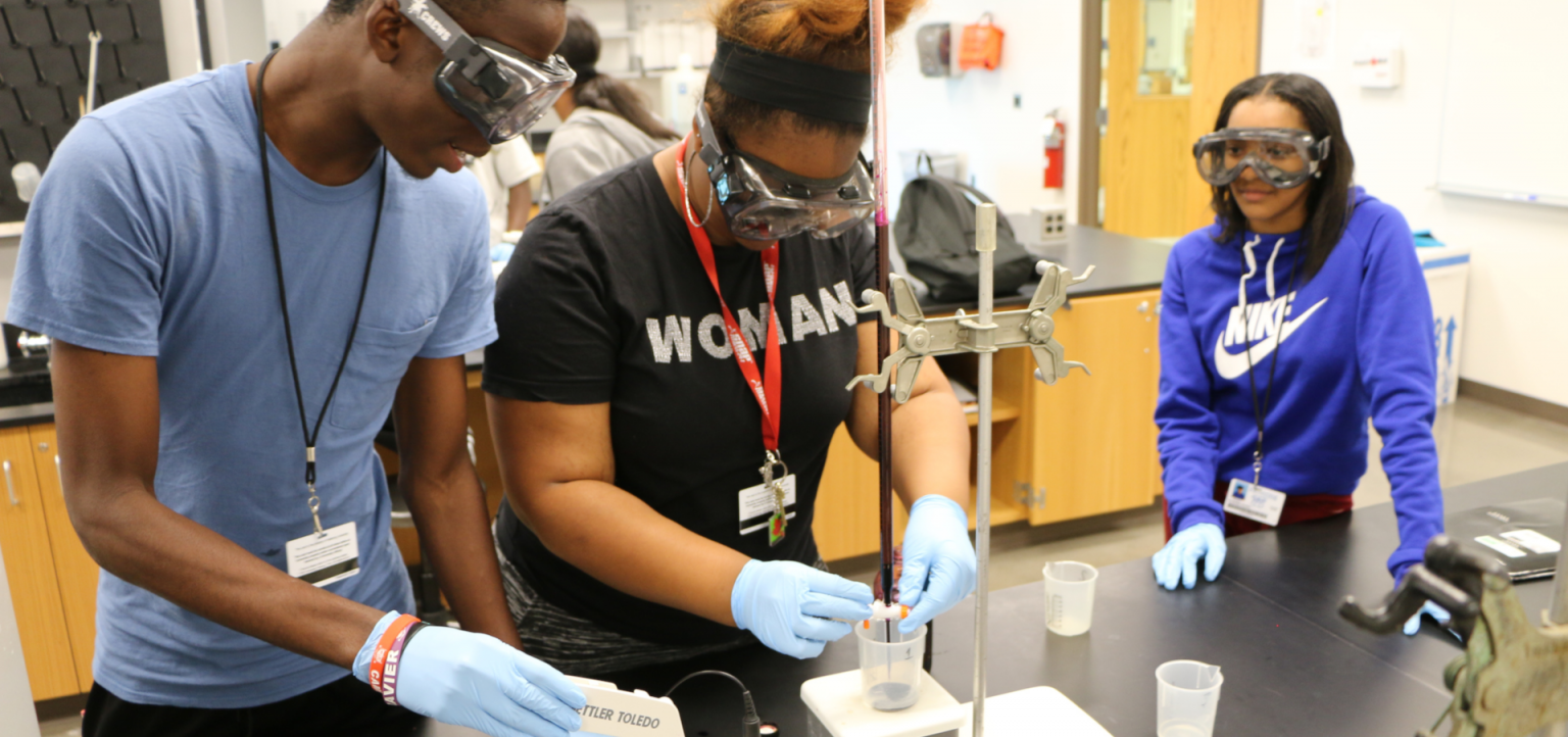 Precollege students in the AIM program work in a lab.