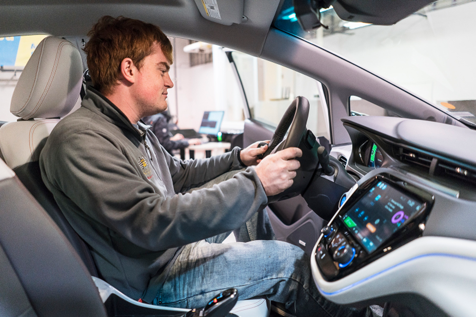 Student behind the wheel of self-driving car.