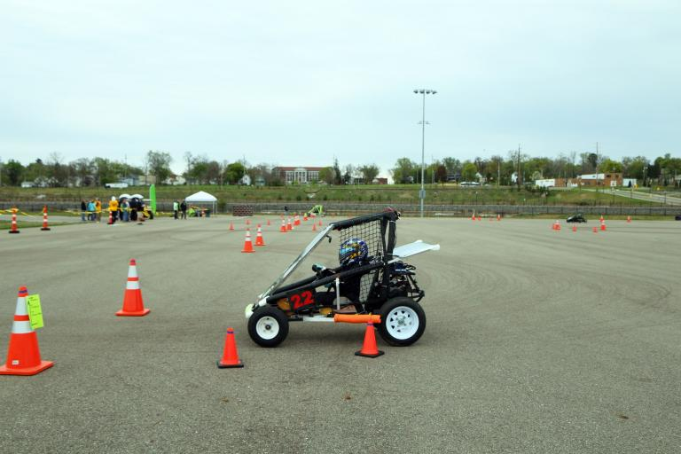 A high school student drives a go kart during the 2019 Square One's Innovative Vehicle Design Challenge at Kettering University.