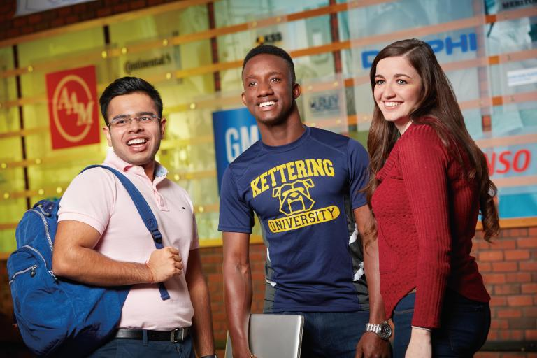 Students in the Campus Center in front of the Employer Wall