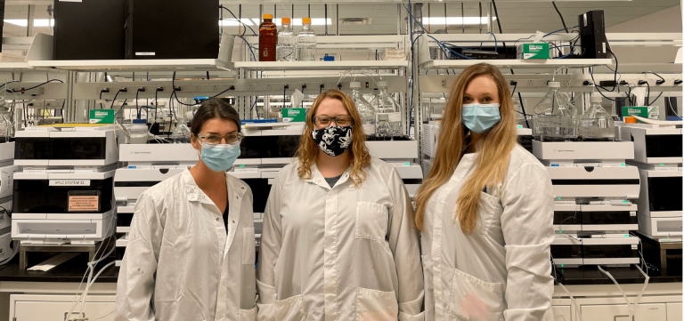 Three Kettering University alumnae post in a lab.